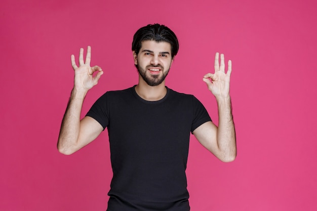 Man in black shirt feels positive about something and enjoys it
