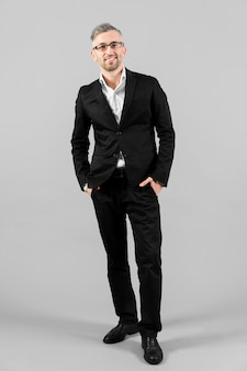 Man in black suit standing long view