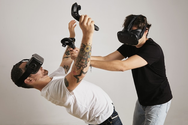 A man in a black unlabeled t-shirt tries to kill a man in a white t-shirt in a vr game isolated on white