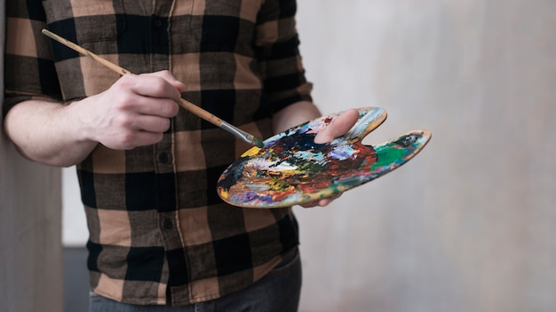 Man blending colors for his painting