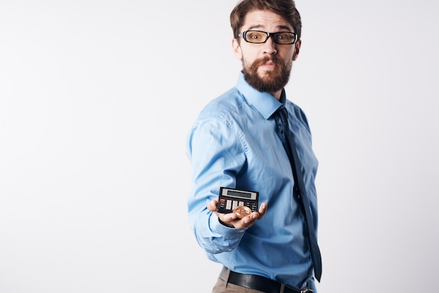 A man in a blue shirt with a calculator in his hands finance professional
