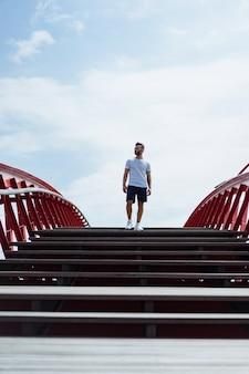Man on the bridge in amsterdam, python bridge