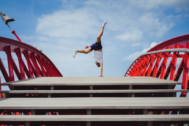 Man on the bridge. handstand breakdance