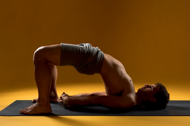 Man in bridge pose