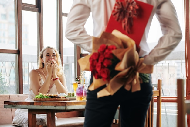 Man bringing gifts on date