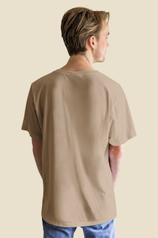 Man in brown blue jeans t-shirt