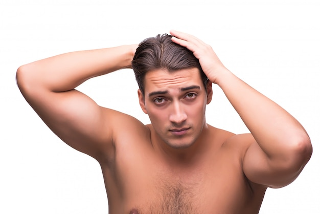 Man brushing his hair isolated on white