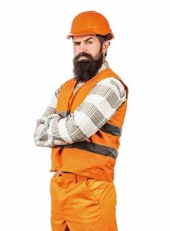 남자 빌더, 산업. 건설 유니폼에 노동자입니다. 건축가 빌더. 헬멧 또는 하드 모자를 구축에 수염을 가진 수염 난된 남자 노동자. 하드 모자 작성기