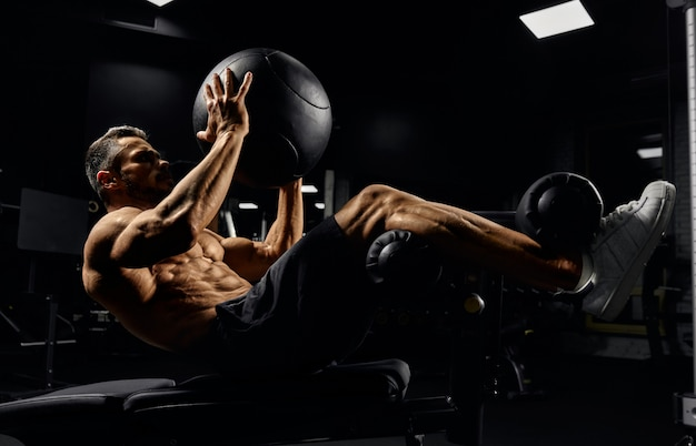 Man building core muscles with ball.