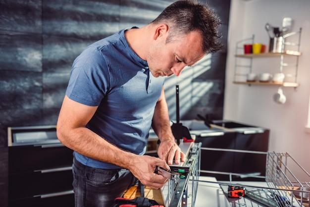 Man building kitchen cabinets