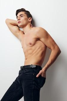 Man bulging torso nude pants model side view