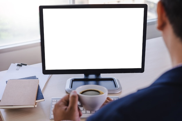 Man of business man hand working on laptop computer blank white screen laptop