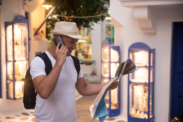 Man on business trip using his smartphone