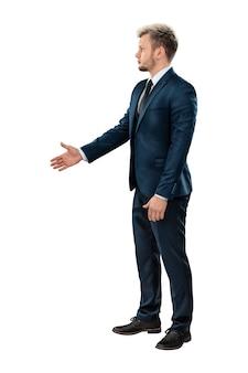 完全な成長の握手ジェスチャーでビジネススーツの男性実業家