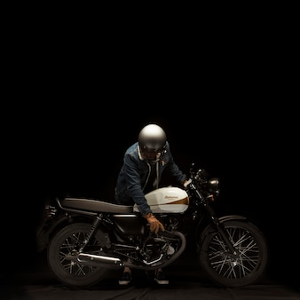 Man on cafe racer style motorbike