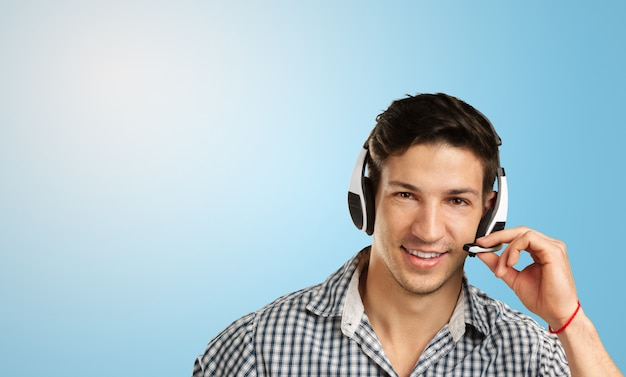 Man call center manager with headset on his head