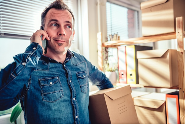 Man calling package delivery service