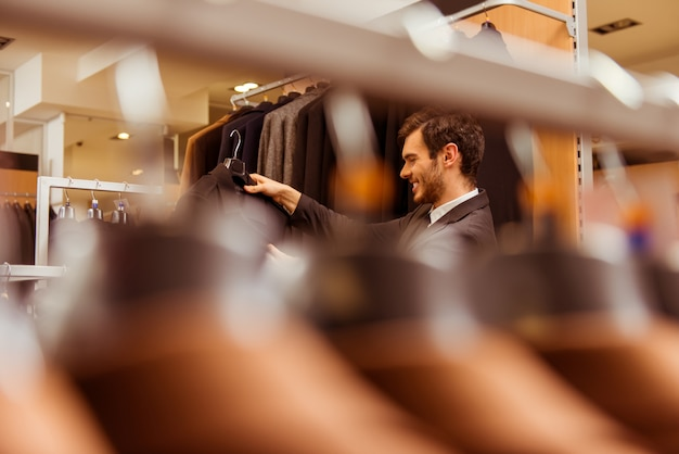 A man came to a clothing store to select a suit.
