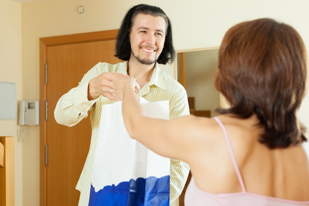 Man came to woman with gift at home