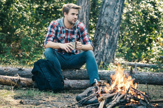 Man camping in forest tourists relaxing tourism concept picnic time