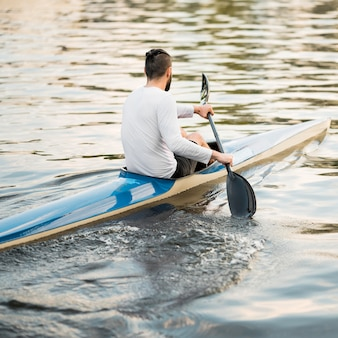 Man in canoe on lake