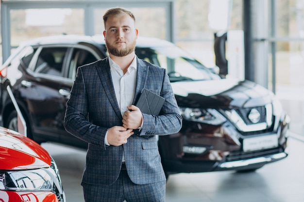 Man in car showroom choosing a car