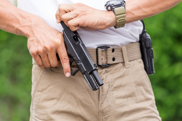 Man in cargo pants with gun