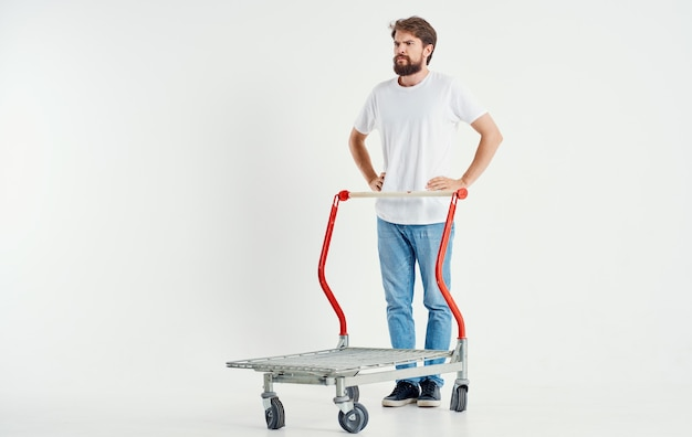 A man in a cargo trolley on a light space superhero transporting heavy objects
