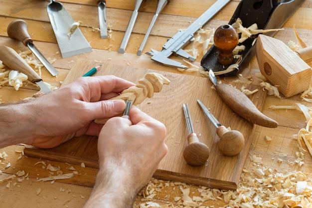 Man carving in workshop