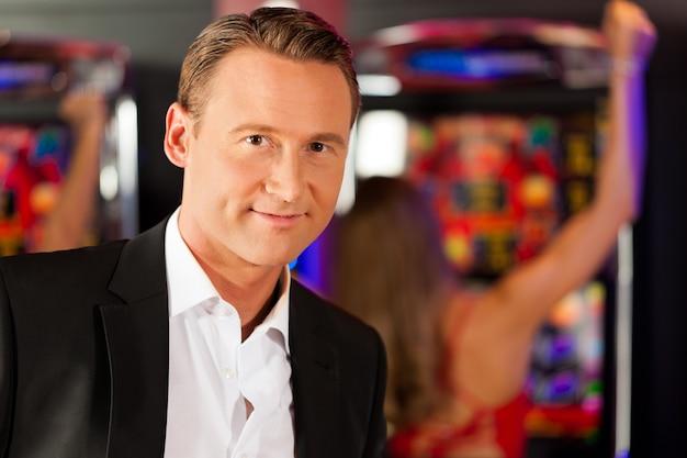 Man in casino on slot machine
