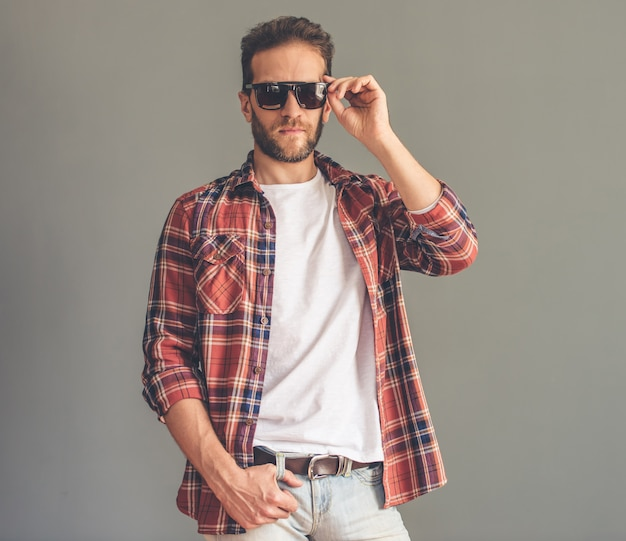Man in casual clothes and sun glasses