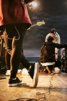 Man casually standing on the stage