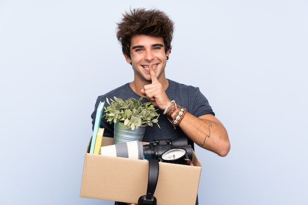 Man catching a box full of things over isolated wall