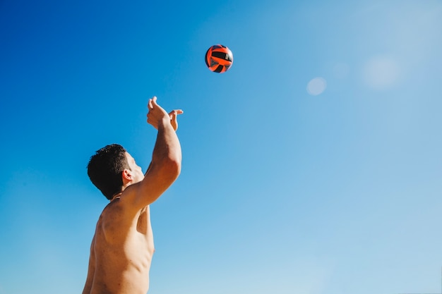Man catching volleyball