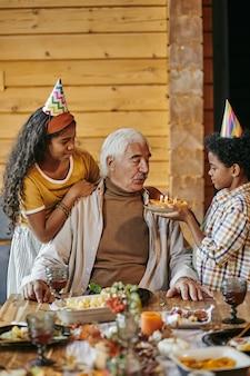 Man celebrating birthday with his family