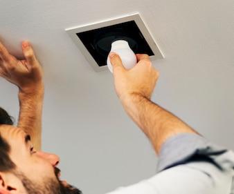 Man changing a light bulb