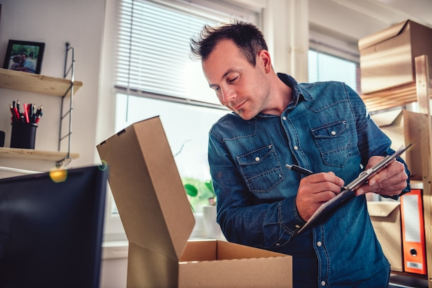 Man checking package for delivery