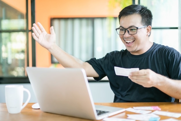 Man checking results of lottery on laptop and winning
