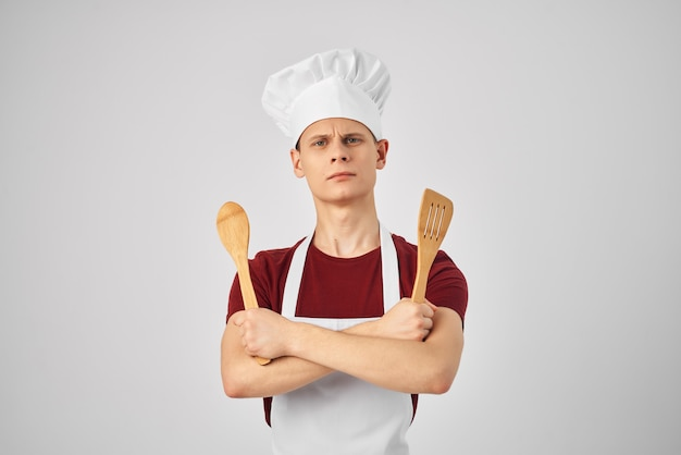 Man in chef uniform cooking kitchen lifestyle. high quality photo