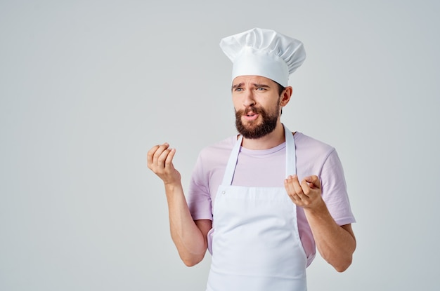 Man in chefs clothes emotions kitchen work cooking