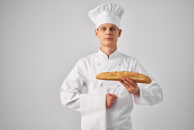 Man in chefs clothes professional work bakery light background