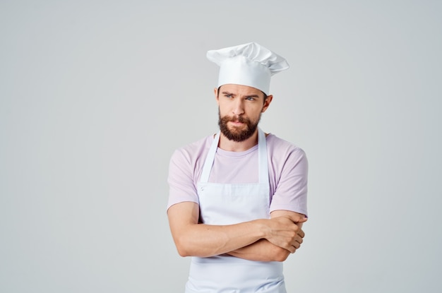 Man in chefs clothes professional work cooking