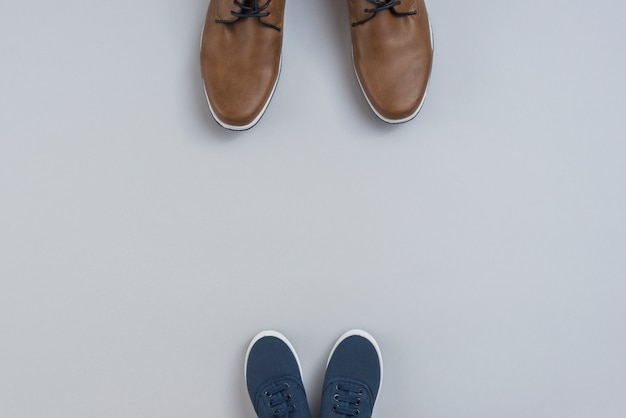 Man and children shoes on table