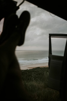 Man chilling in his car by the ocean