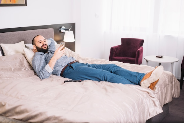 Man chilling with smartphone