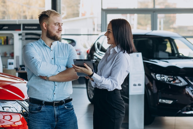 Man choosing a car and talking with salesperson