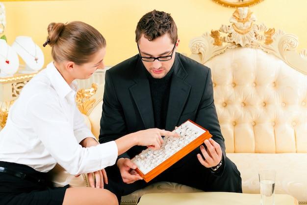 Man choosing a ring at the jeweler