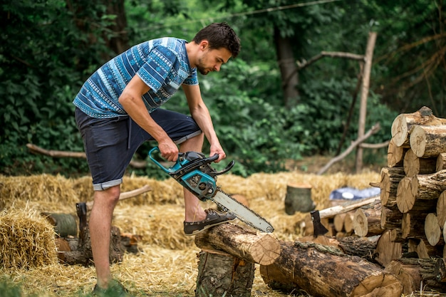 Man chopping wood with a chainsaw