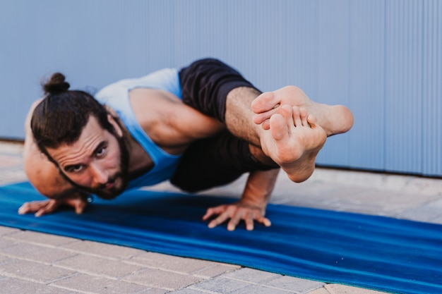 Man in the city practicing yoga sport