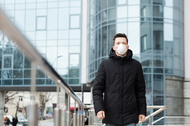 Man in the city wearing jacket and medical mask